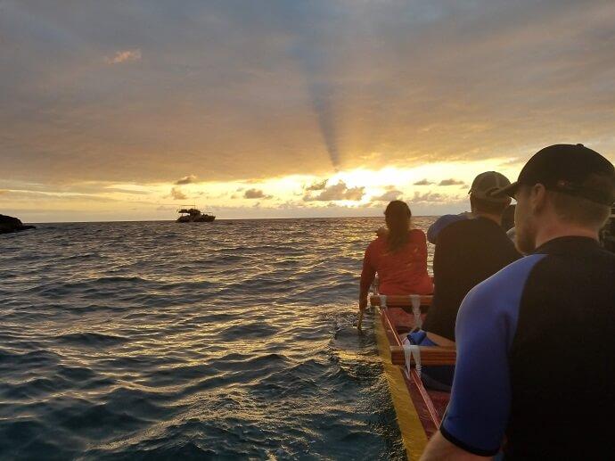 outrigger canoe sunset